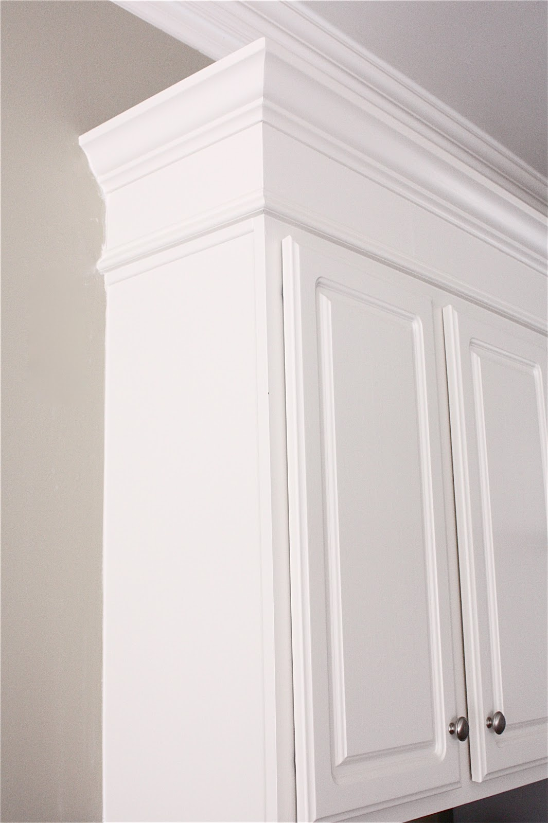 the yellow cape cod making cabinets taller builder cabinets go custom with molding. Black Bedroom Furniture Sets. Home Design Ideas