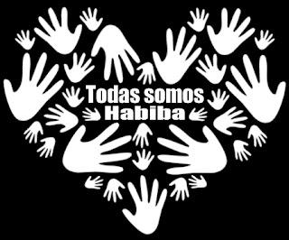 """Manos blancas formando un corazón sobre fondo negro y en el centro las palabras """"Todas somos Habiba"""""""