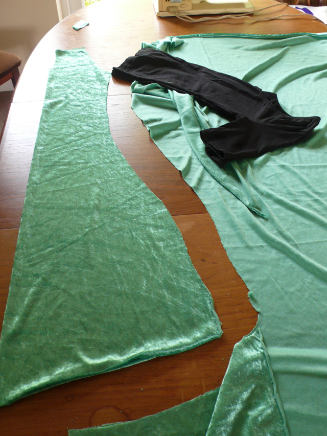 Cutting out a pattern using a t-shirt as a guide.