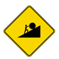 road sign of Sisyphus pushing a boulder up a hill