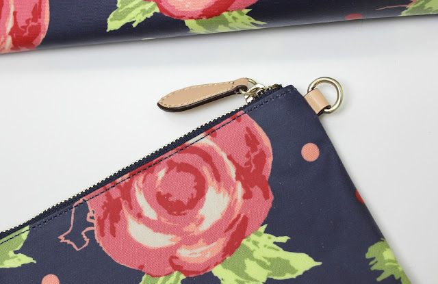 The Radley Autumn Rose Detachable Pouch is perfect for all your gadgets and makeup must-haves