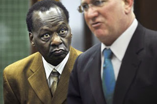 President Obama's half uncle with his lawyer in court.