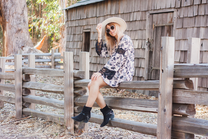 Bryn Newman of Stone Fox Style in Big Sur, California wears a floral and lace bell sleeve dress from Charlotte Russe and wears a white wide brim fedora from Goorin Brother's a San Francisco Hat shop