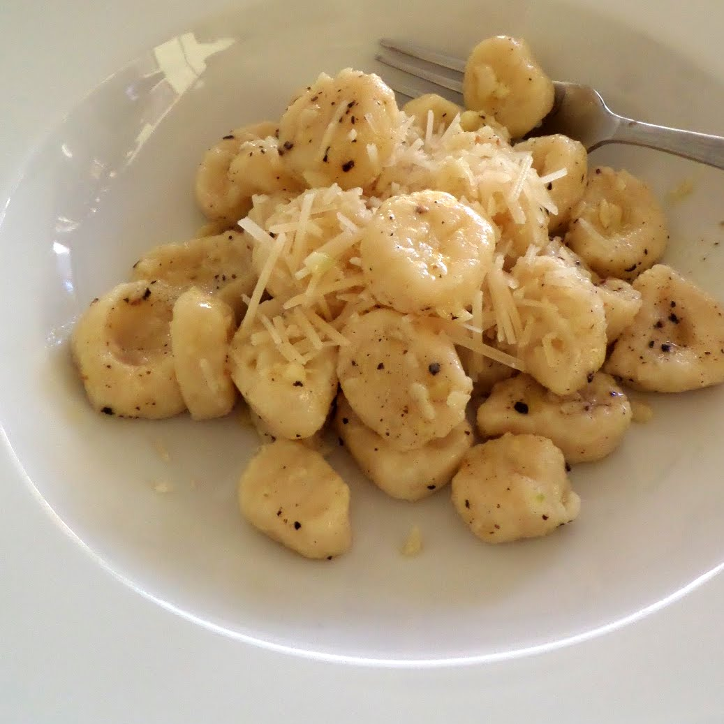 Garlic Butter Gnocchi:  Soft fluffy pillows of warm potato gnocchi tossed in a garlic butter sauce and topped with Parmesan cheese.