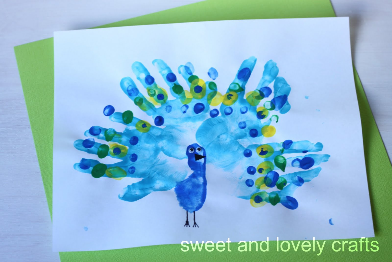 Sweet and lovely crafts handprint peacocks for Crafts with hands