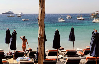 Lounge in the sun with the rich and famous on Psarou Beach, Mykonos, Greece. #mojotravels