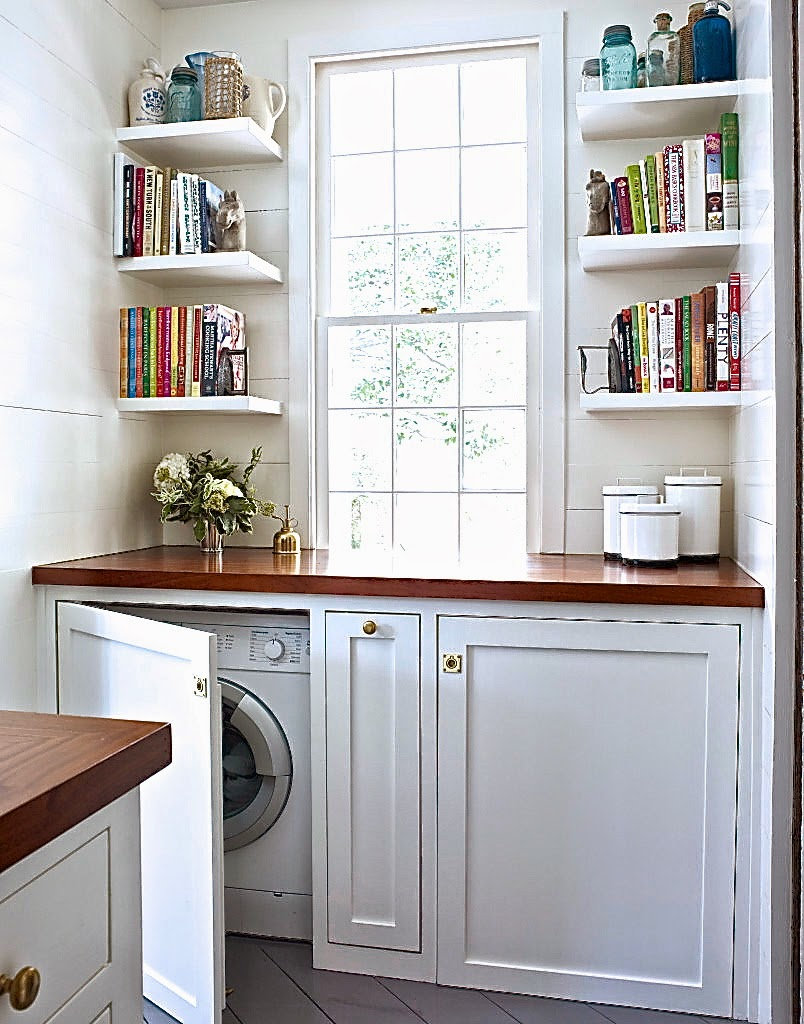 Kitchen with hidden washer and dryer