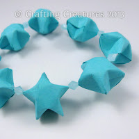 http://paperzen.blogspot.ca/2013/04/folded-lucky-stars-tutorial.html