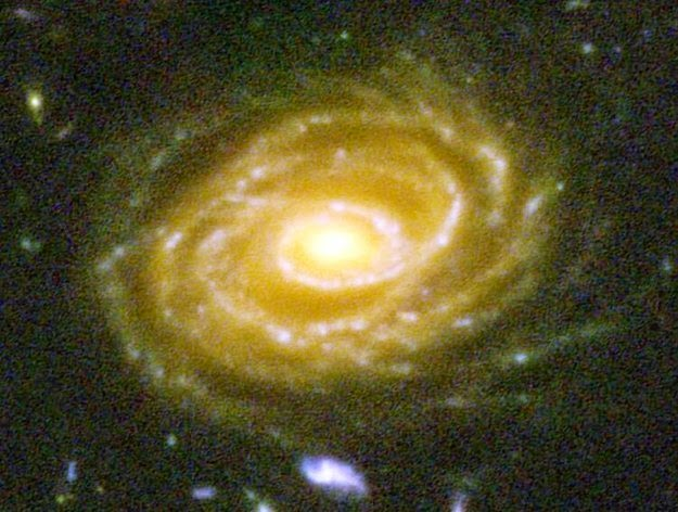 26 Pictures Will Make You Re-Evaluate Your Entire Existence - HERE'S ONE OF THE GALAXIES PICTURED, UDF 423. THIS GALAXY IS 10 BILLION LIGHT YEARS AWAY. WHEN YOU LOOK AT THIS PICTURE, YOU ARE LOOKING BILLIONS OF YEARS INTO THE PAST