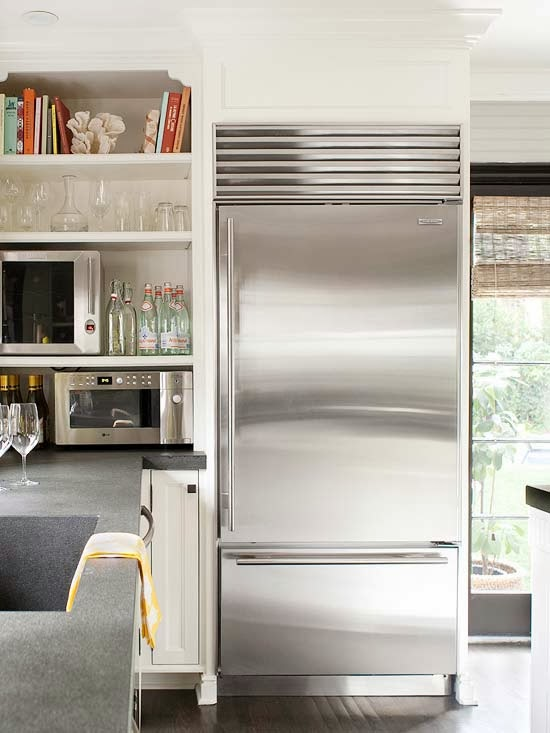 A Firm Believer In Open Storage, This Homeowner Uses Shelves To Keep  Everyday Items Easy To See And Reach. Shelves Next To The Refrigerator Hold  The ...