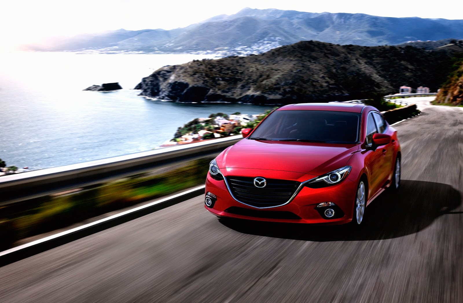 Front 3/4 view of the 2015 Mazda 3