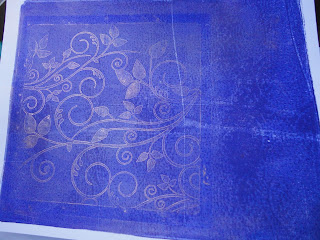 Cobalt blue gelli plate background with bronze swirl