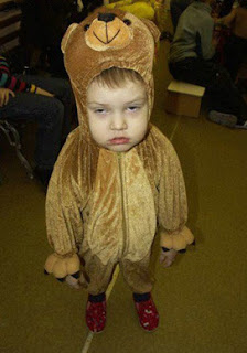 cute kid in a bear suit