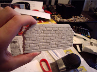 Plaster of Paris bridge abutment with carved bricks