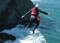 A Man Jumping Off a Cliff whilst Coasteering