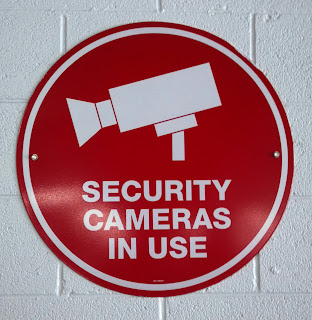 security cameras in use sign with picture of camera