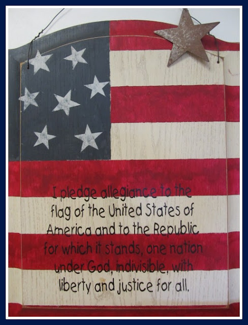 photo of: Pledge of Allegiance on Wooden Flag