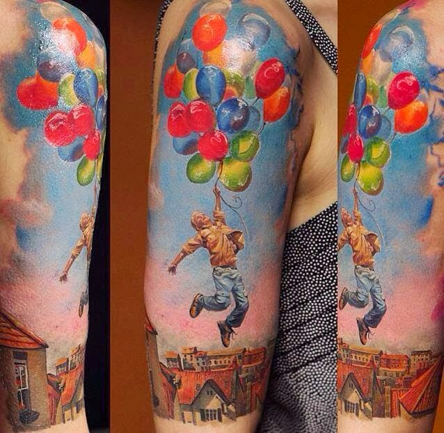 Colorful balloons and jumping man tattoo on arm