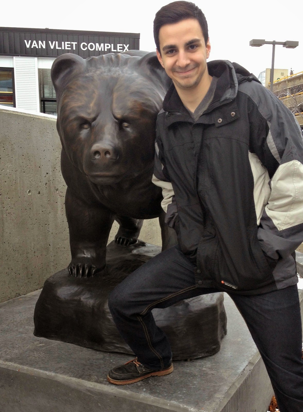Posing in front of PAW with the Alberta Bear