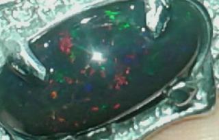 batu black opal banten