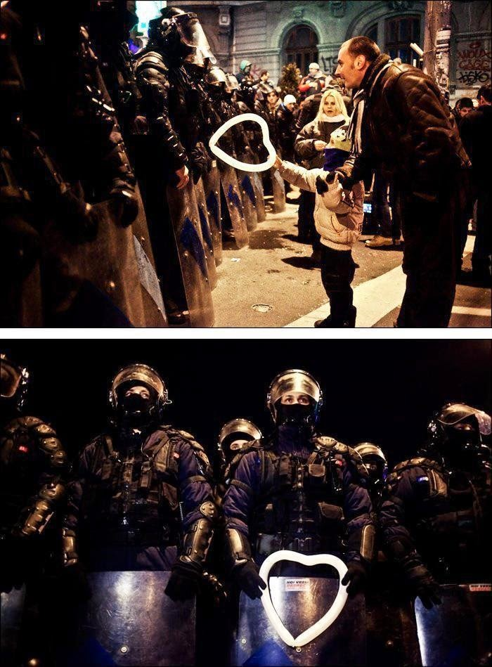 35 moments of violence that brought out incredible human compassion - a young boy offers a heart-shaped balloon to police