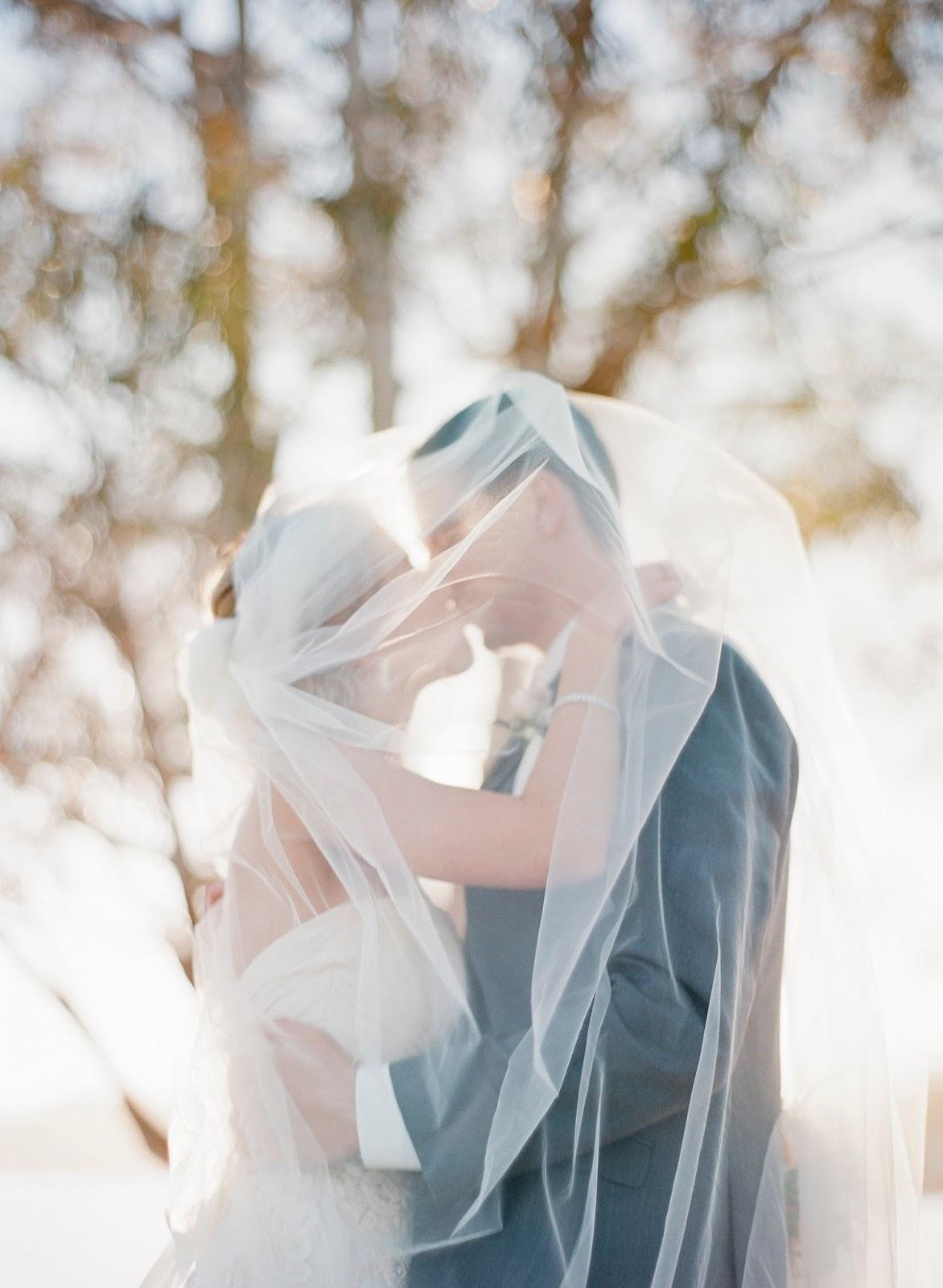 kissing under bridal veil