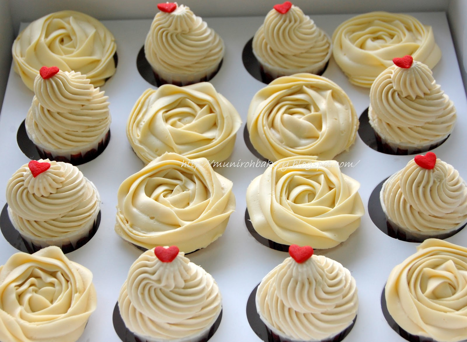 Red velvet cuppies with cream cheese and vanilla frosting for Bakery decoration