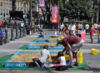 temporary sandbox in New York City Summer streets project