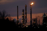 An ExxonMobil refinery in Louisiana. More than 40 environmental and other groups called for a federal investigation of the oil-and-gas company. (Credit: Gerald Herbert/Associated Press) Click to Enlarge.