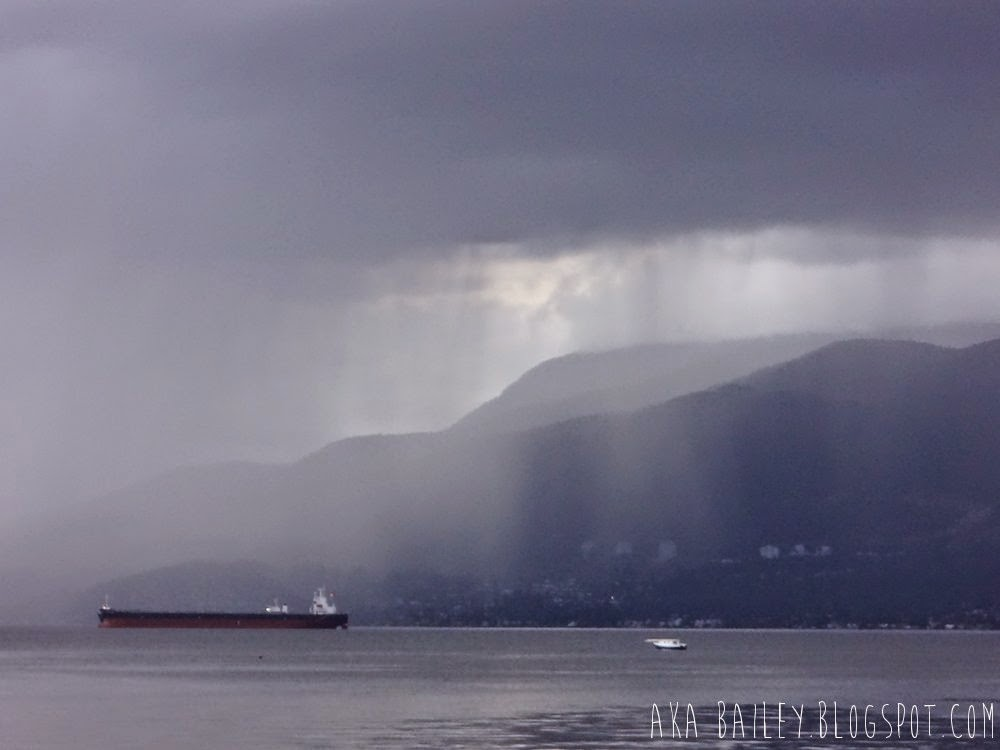 Rain cloud over West Vancouver, raining on the tankers in English Bay