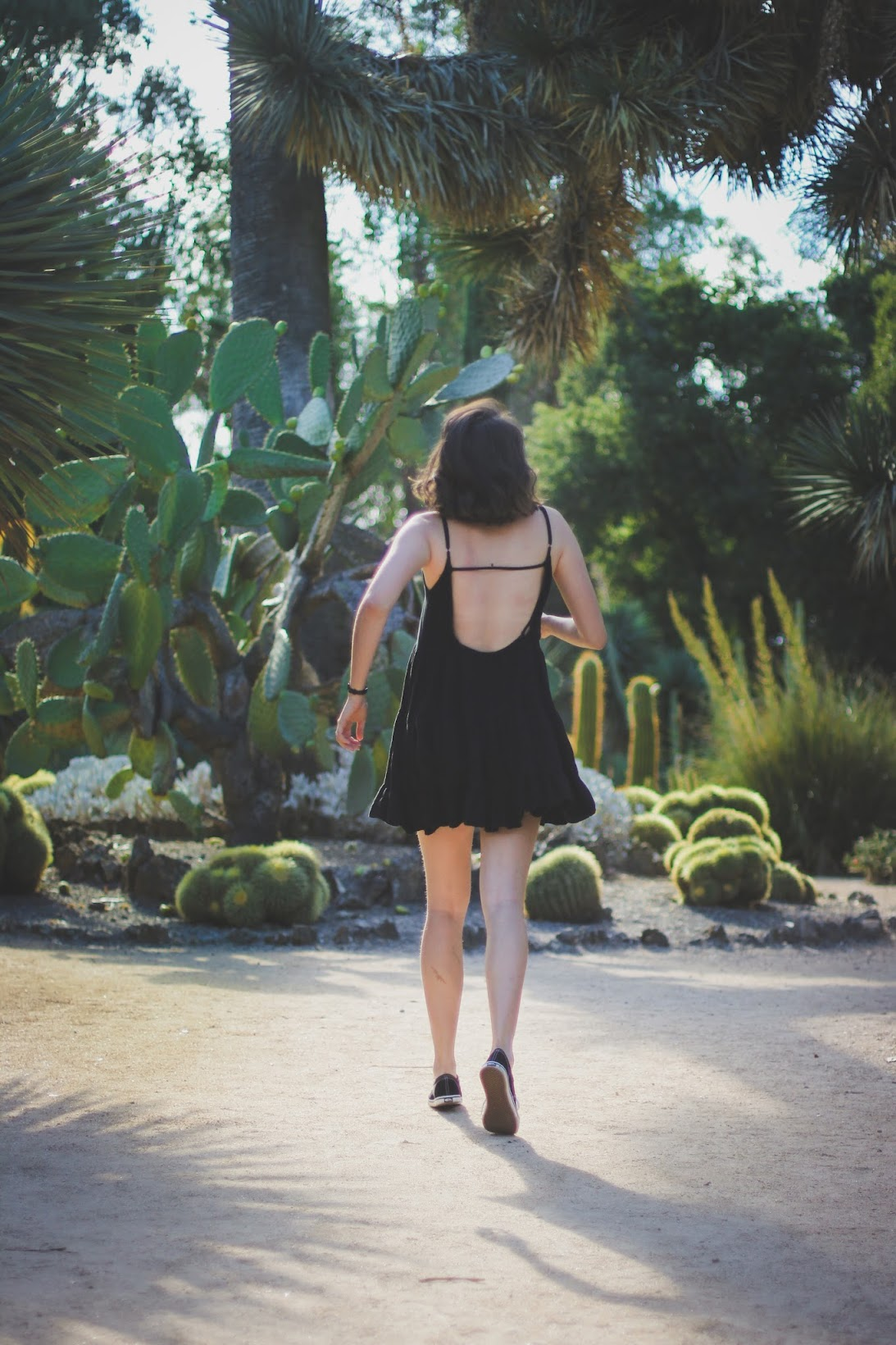 Black Brandy Melville Jada dress in a cactus garden.