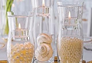 pérolas, conchas, velas, vidros, decoração