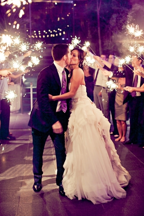 Wedding Sparklers Ideas and Inspiration - Sparklers as the Bride and Groom Share a Kiss
