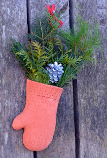 Christmas mitt with greenery