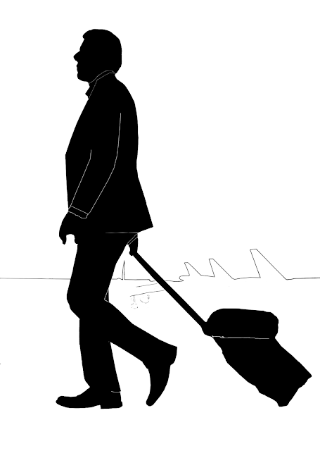 silhouette of a man in a jacket with a trolley bag