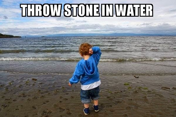 kid throwing stone in water