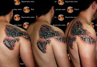 biomechanical tattoo on the back and shoulder