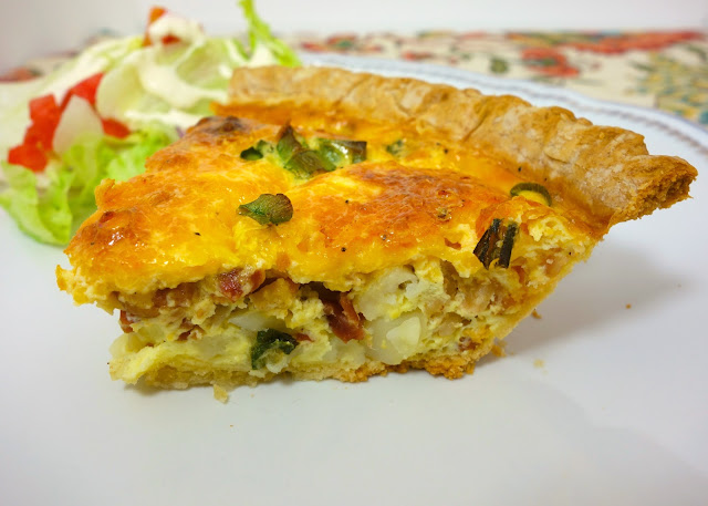 Loaded Potato Quiche - pie crust filled with diced potatoes, bacon, cheddar, green onions, eggs, milk and sour cream. Can mix together and free unbaked for a quick meal later. One of our favorite quiche recipes! Great for brunch, lunch or dinner!!!