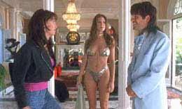 Nikki Cox looking sexy in a gold bikini in Run Ronnie Run movieloversreviews.filminspector.com