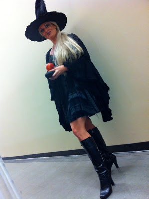 Woman in Wicked witch costume holding apple