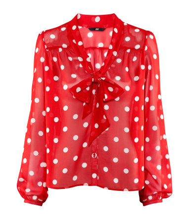 A black and white polka dot blouse is a style staple to keep on hand, but it's also possible to find the tops in any hue with any color of dots such as blue polka dot blouses. The tops come in long sleeve, short sleeve, or sleeveless, have large dots or small, are off-the-shoulder or button-down, .