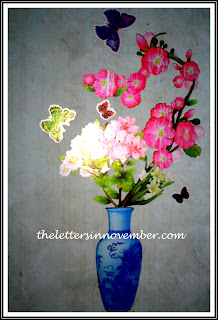 flower vase and butterflies