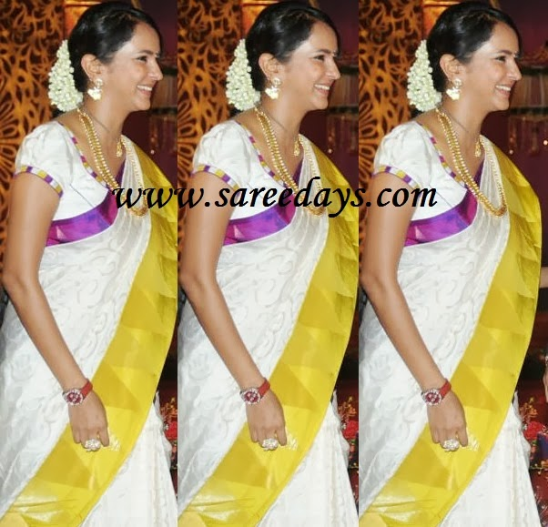 Latest saree designs lakshmi manchu in white uppada pattu saree checkout lakshmi manchu in white uppada pattu saree with purple and mustard double sided border and paired with ruffled short sleeves blouse altavistaventures Image collections