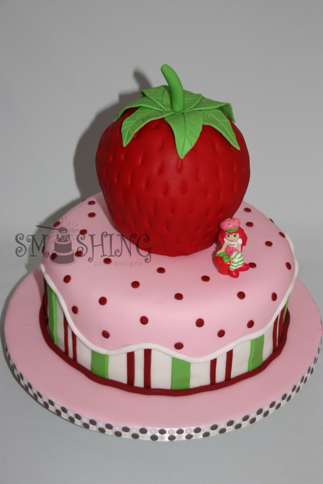 strawberry is cake carved to resemble a strawberry then covered in ...