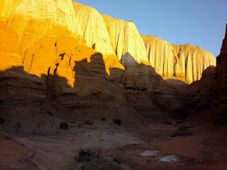 Photograph of Red Rock cliffs with Harsh Light and Shadow.