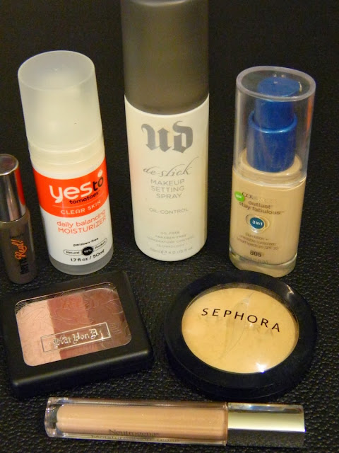 YesTo Tomatoes daily balancing moisturizer, Urban Decay De-Slick makeup setting spray, Covergirl Outlast Stay Fabulous 3 in 1 foundation, Sephora MicroSmooth face powder, Kat Von D True Romance Eyeshadow in fever ray, Benefit They're Real! mascara, Neutrogena MoistureShine gloss in natural boost