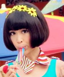 Ribbon Ooi sucking on lollipop in Kara King