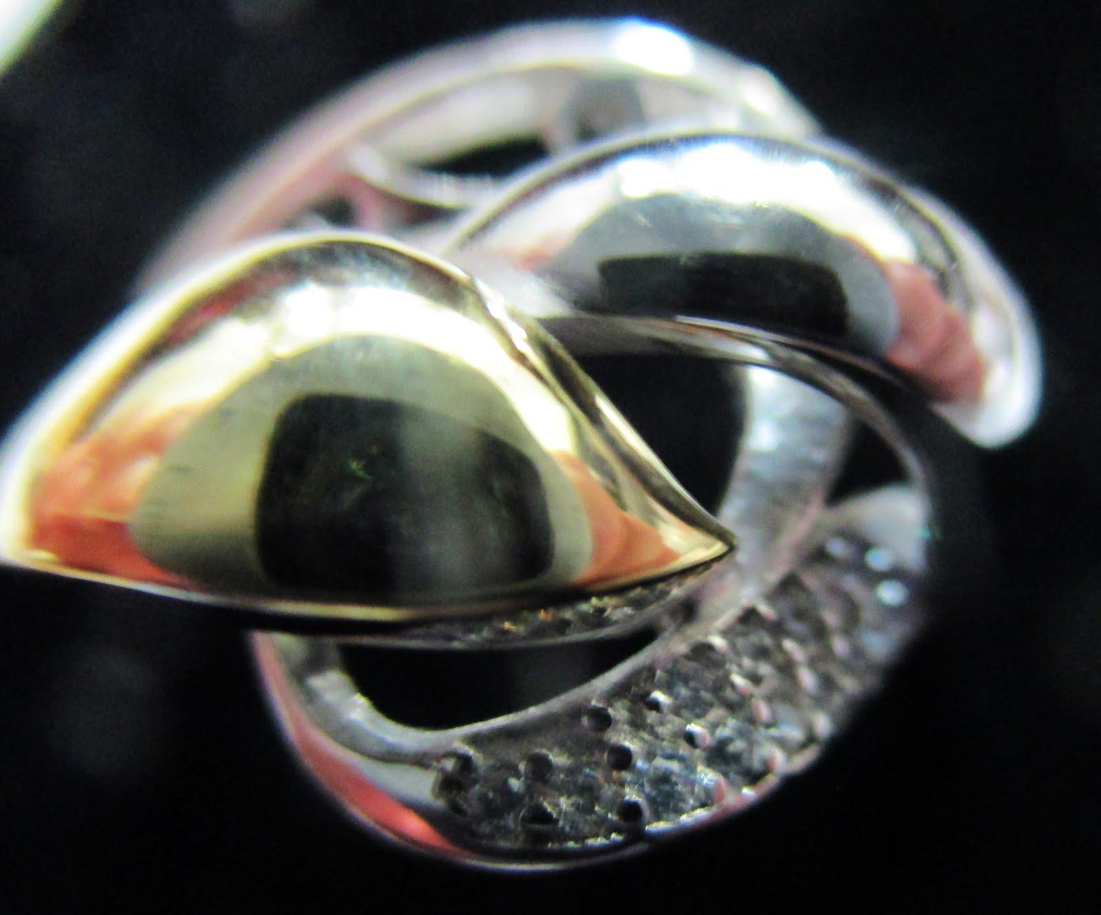 Sortija plata bicolor y circonitas