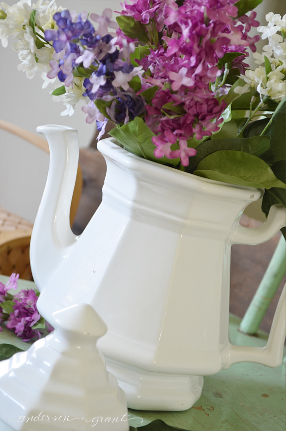 Thrift store white teapot filled with flowers