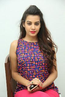 Deeksha Panth in Beautiful Purple Top and Red Leggings in Kavvintha movie